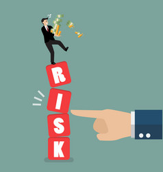 Businessman standing on shaky risk blocks by hand vector