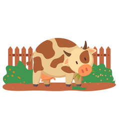 spotted cow near fence and green bushes vector image