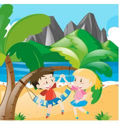 boy and girl on the beach vector image