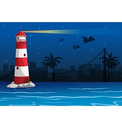 A bright lighthouse in the middle of the sea vector image vector image