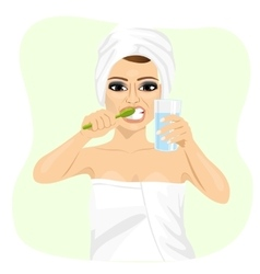 Attractive young woman brushing teeth vector