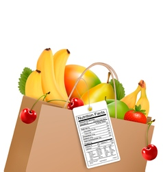 Shopping bag with healthy fruit and a nutrient vector image