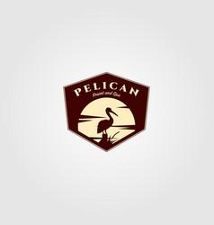 pelican bird logo vintage with sun background vector image