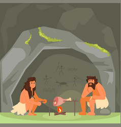 Stone age couple cooking meat vector