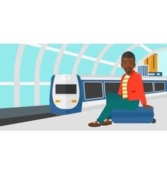 Man sitting on railway platform vector