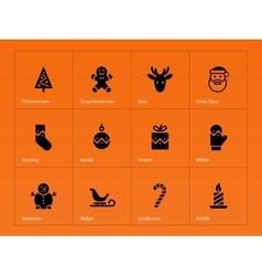 Christmas icons on orange background vector image