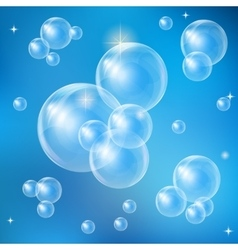 Soap bubbles on a blue background vector image