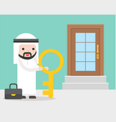 arab businessman and big key standing in front of vector image