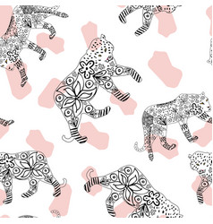 Hand drawn tiger and leopard spotted background vector