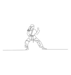 karate girl is standing in a fighting pose vector image