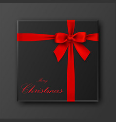 black gift box with merry christmas text red bow vector image