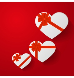 Heart-shaped gifts with red bow on red background vector