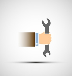 Hand holding a wrench vector