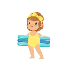 sweet little girl in a yellow swimsuit holding vector image