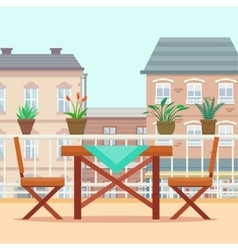 Table and chairs on the balcony vector image