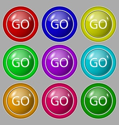 GO sign icon Symbol on nine round colourful vector