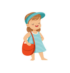 Cute little girl in a blue visor standing with bag vector