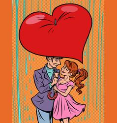 Couple in love under an umbrella heart valentine vector