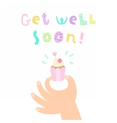 Get well soon hand holding a cupcake vector