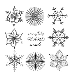 Set of different hand drawn snowflakes vector image