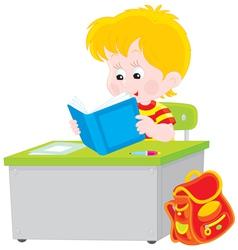 schoolboy reading a textbook vector image