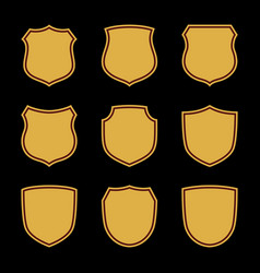 Shield shape gold icons set simple flat logo on vector