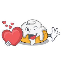 With heart cinnamon roll mascot cartoon vector