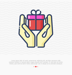 two hands are holding a gift vector image