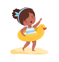 cute girl standing with inflatable yellow duck vector image