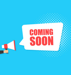 male hand holding megaphone with coming soon vector image