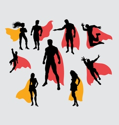 Superman and supergirl silhouettes vector image