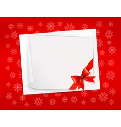 Christmas sheet of paper and red ribbon gift vector image vector image