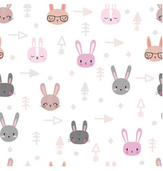 Tribal seamless pattern with cartoon rabbits vector