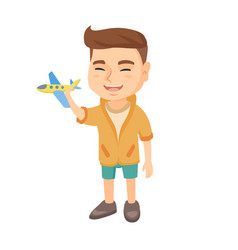 caucasian cheerful boy playing with a toy airplane vector image