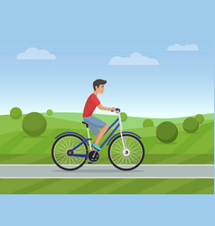 young man riding a sport bike on a park road vector image