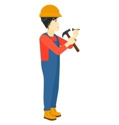 Man hammering nail vector image