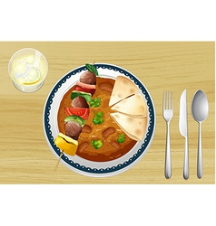 A meat a bean curry and a bread vector image