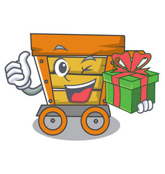 With gift wooden trolley mascot cartoon vector