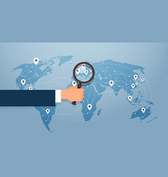 Hand hold magnifying glass over world map vector