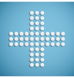 Medical cross from pills vector