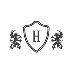 heraldic lions and monogram on shield isolated on vector image vector image