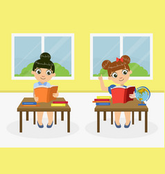 cute little girls sitting at desk and reading vector image