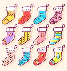 various Christmas decorated socks on ligh vector image