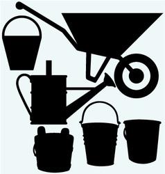 Garden wheelbarrow watering can and buckets vector image vector image