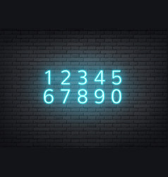 neon alphabet retro numbers on brick wall vector image