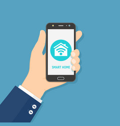 hand holding mobile smart phone with smart home vector image