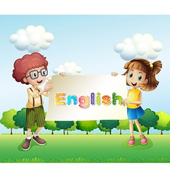 A boy and a girl holding a banner vector image