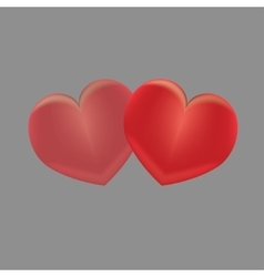 Two red hearts on a gray background vector image