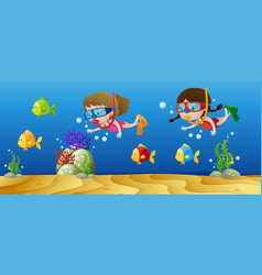 two girls diving under the ocean vector image vector image