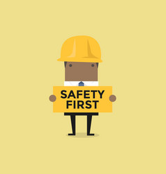 African businessman holding safety first sign vector